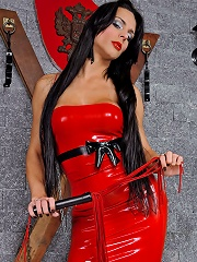 Shemale mistress Viviany in red latex