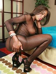 Horny ebony shemale Lina posing in hot fishnet costume